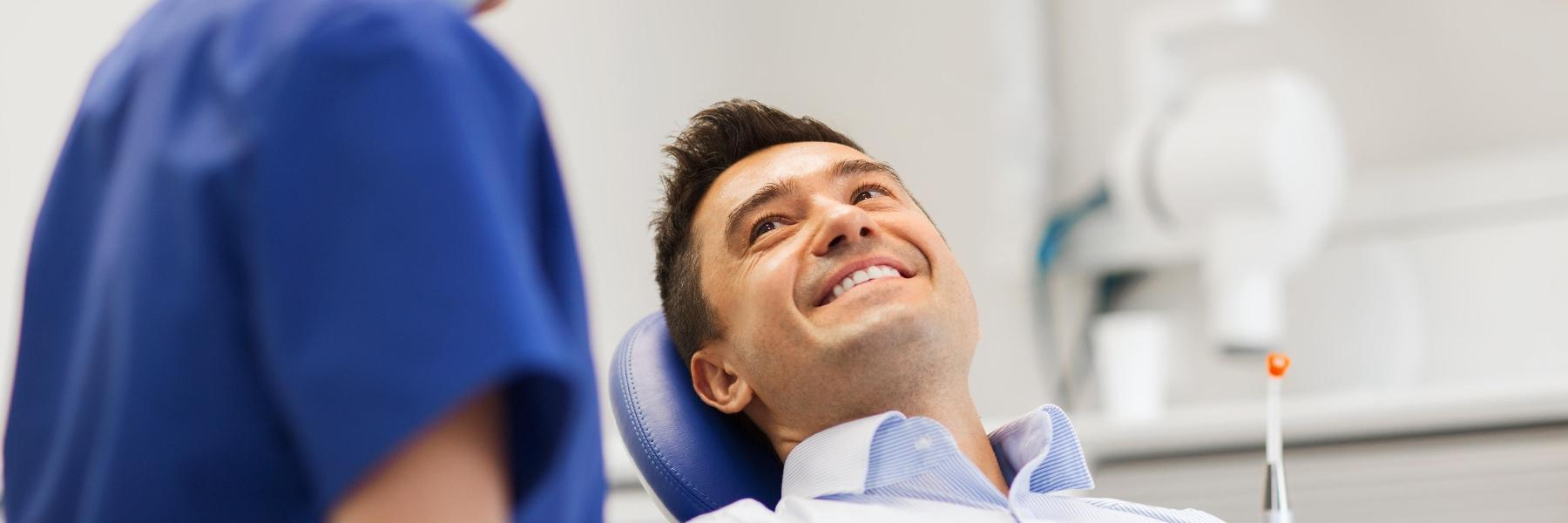 man at dentist before root canal in alderley